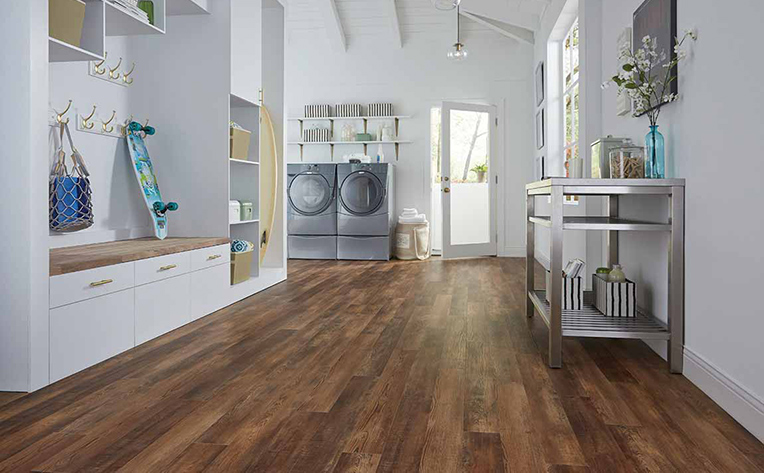 Dark Hardwood Floor in mud room with washer and dryer